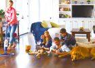 familiy gathers on engineering hardwood floor by hardwood flooring services