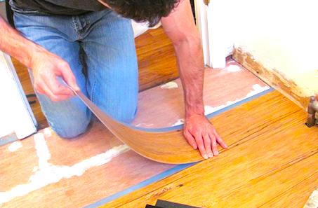 man-installing-vinyl-flooring-in-bathroom-or-installing-vinyl-floor-tiles