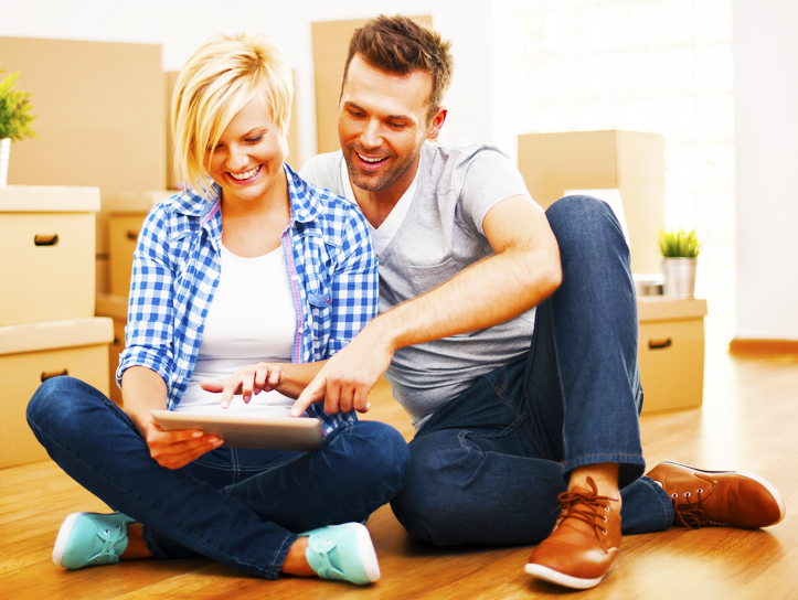 a-young-couple-find-cheap-house-for-sale-with-online-real-estate-website