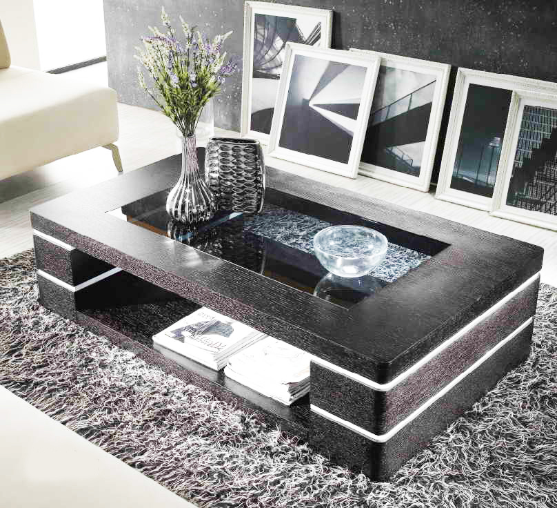 small-modern-coffee-table-designs-from-solid-black-wood-coffee-table-and-small-glass-on-top-coffee-table-designs-in-curve-shape-with-grey-carpet