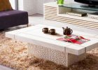 small white modern coffee table with modern couches in living room end tables with storage
