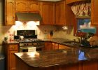 espresso kitchen cabinets with brown kitchen cabinets also with white spring granite countertops are staining kitchen cabinets