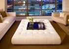 large white tufted leather coffee tabe ottoman for living room apartement with big windows
