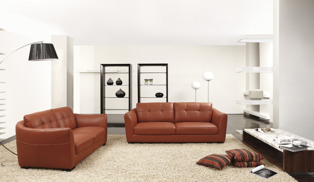 Modern living room sofa for family coziness roy home design for Leather sofa family room