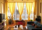 living room window treatments with custom curtain drapes for living room window drapes with blue sofa for living roomwith wood flooring