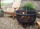 metal outdoor fire pit with modern fire pit and wood chair set for patio