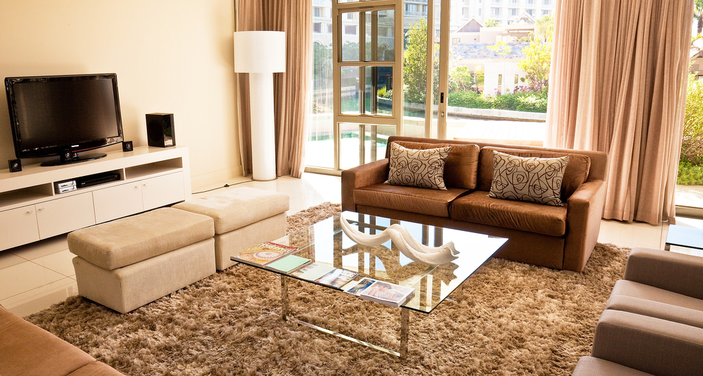 glass-coffee-table-on-top-with-metal-legs-for-modern-rectangle-coffee-table-living-room-decorations-with-wool-carpet-and-sectional-sofa
