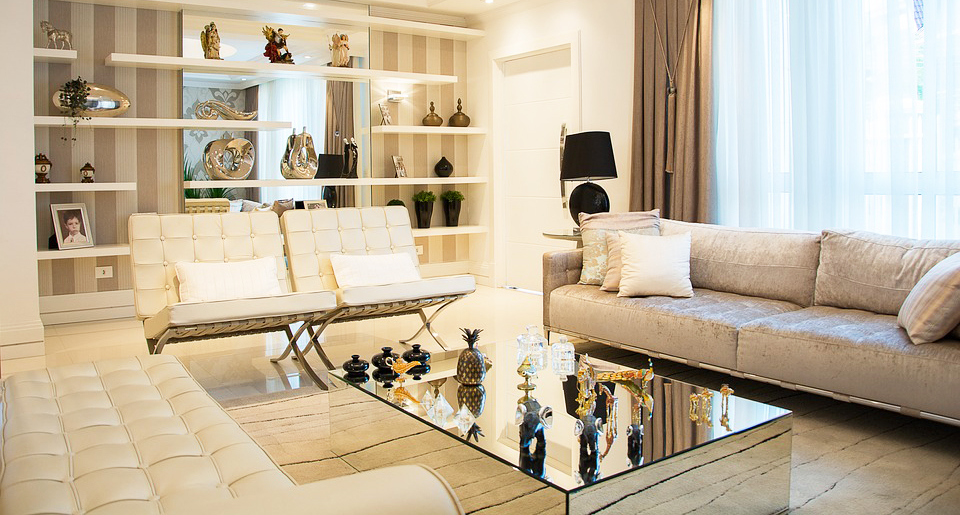 glass-rectangle-coffee-table-with-mirror-body-for-elegant-table-living-room-with-tufted-white-sofa