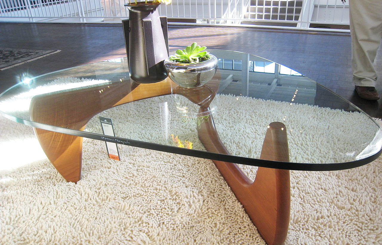 modern-glass-coffee-table-with-glass-on-top-table-with-metal-legs-for-living-room-with-white-carpets