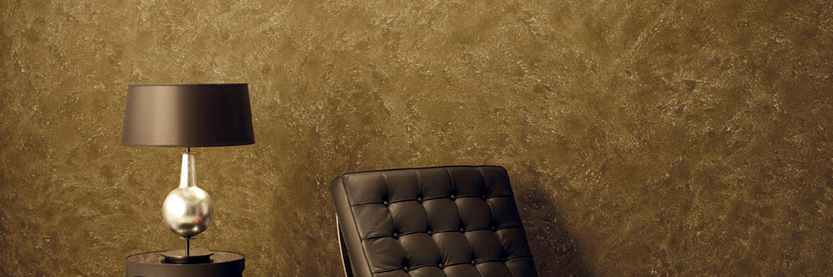 textured-wall-paint-finish-with-brown-paint-colors-with-brown-luxury-tufted-chair-with-lamp-decor