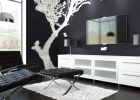 furniture for modern house in black and white color schemes with back leather tufted ottoman chair with white rug area