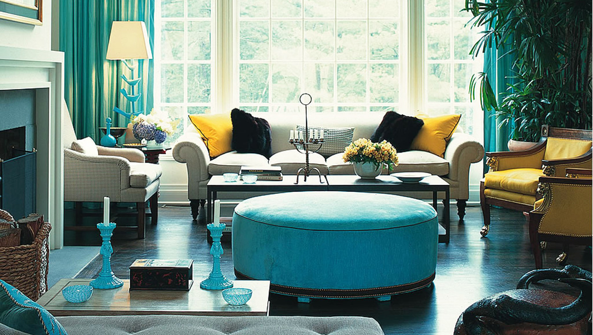 living-room-furniture-arrangement-ideas-round-ottoman-coffee-table-with-curved-modern-sofas-also-table-lamps-windows-curtain-for-wide-windows-as-inspiring-turquoise-living-room