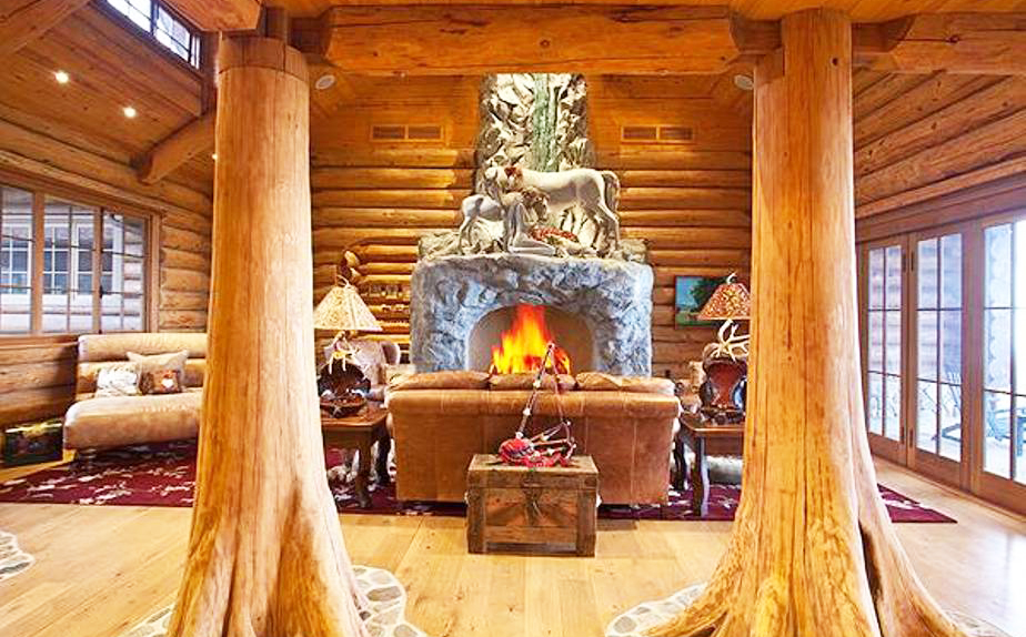 rustic-home-ranch-style-with-fireplace-and-leather-seating-and-tree-pillars