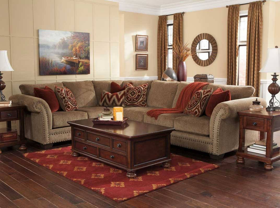 living rooms with brown leather sectionals couch furniture and wooden coffee table with storages