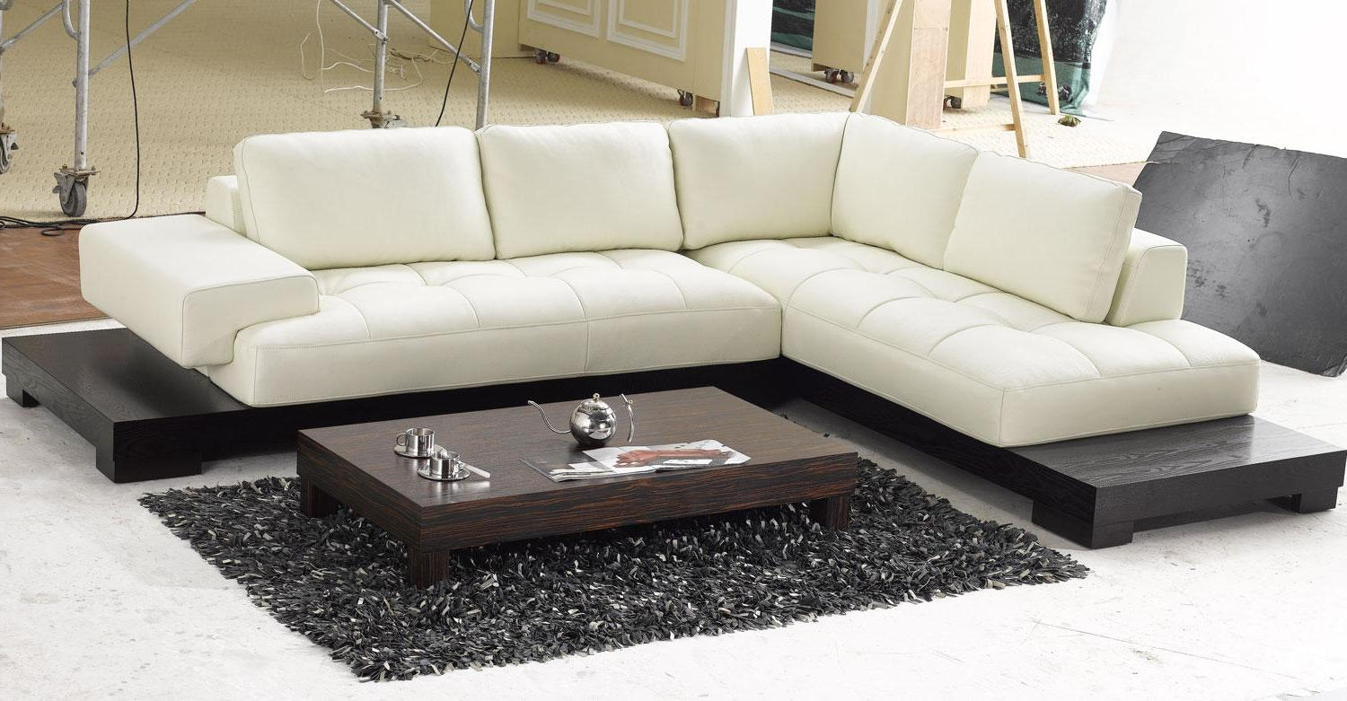 modern living rooms with white leather sectionals couch and black wooden coffee tables