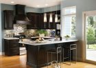 Espresso Kitchen Cabinets triple glass modern pendant lamps over white top kitchen island with sink also contemporary kitchen design