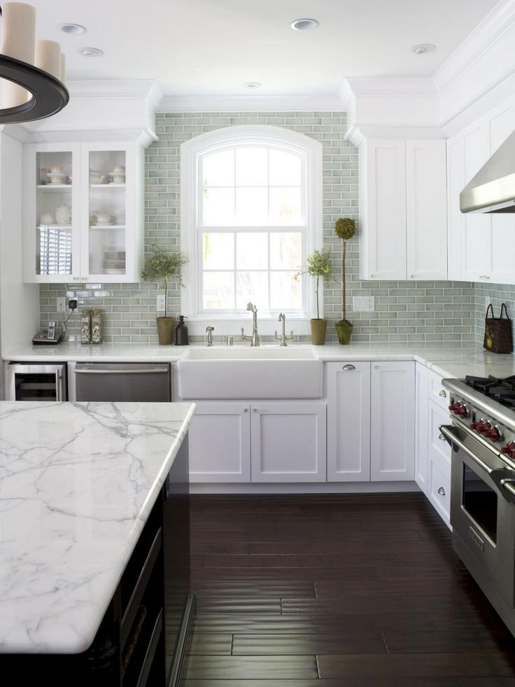 Kitchen Remodels With White Cabinets With Stainless Appliances and Granite Countertops