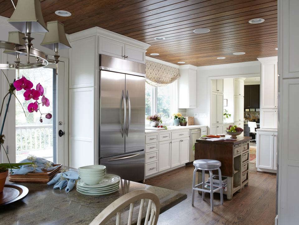 Kitchen Remodels With White Cabinets Wood Floor and Stainless Appliances